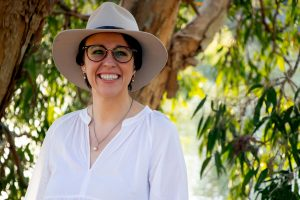 a woman in an a akubra hat and white shirt